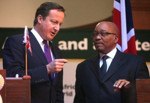 Le Premier ministre britannique David Cameron et le Président sud-africain Jacob Zuma le 18 juillet 2011 à Pretoria AFP Paballo Thekiso