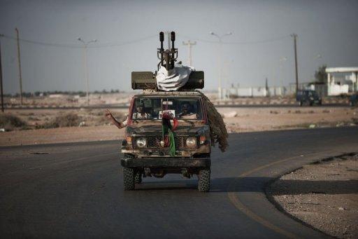 Des rebelles libyens en route pour Brega, le 18 juillet 2011 à Ajdabiya AFP Gianluigi Guercia
