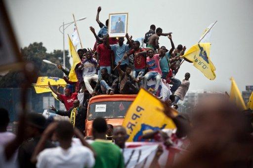 Des partisans de Kabila le 11 septembre 2011 dans une rue de Kinshasa AFP Junior Kannah