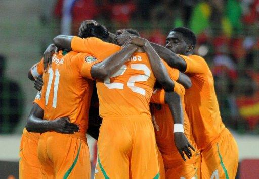 La joie des Ivoiriens, qualifiés pour les demi-finales de la CAN, le 4 février 2012 à Malabo. AFP Alexander Joe