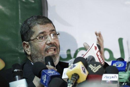 Le numéro un des Frères musulmans en Egypte, Mohamed Mursi, lors d'une conférence de presse le 31 mars 2012 au Caire pour annoncer la candidature de Khairat al-Chater à la présidentielle AFP Gianluigi Guercia