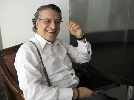 Le directeur de la chaîne privée tunisienne Nessma TV Nabil Karoui, dans son bureau le 3 mai 2012 à Tunis AFP/Archives Fethi Belaid