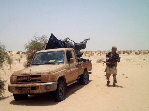 Des rebelles maliens islamistes, le 24 avril 2012 près de Tombouctou AFP/Archives Romaric Ollo Hien