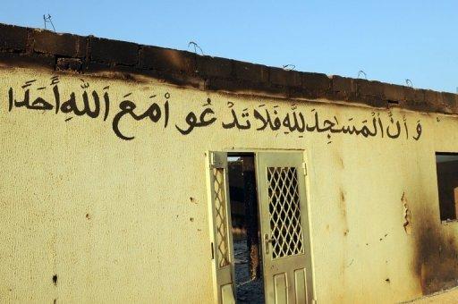 Une mosquée incendiée non loin de la ville de Jos, au Nigeria, en 2010 AFP/Archives Pius Utomi Ekpei