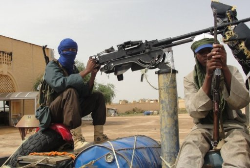 Des combattants islamistes du Mujao, le 7 août 2012 près de l'aéroport de Gao AFP Romaric Ollo Hien