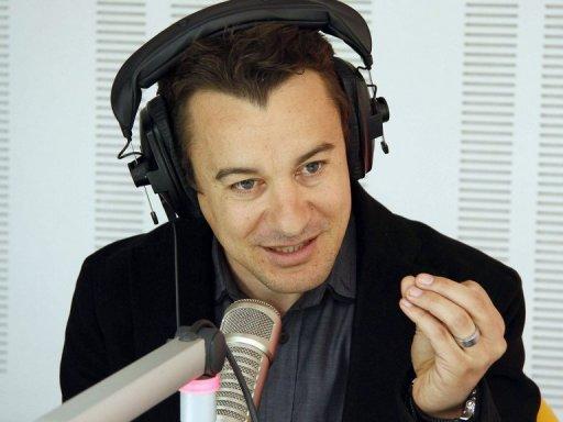 Sami Fehri, le patron de la chaîne tunisienne Ettounsiya TV, le 24 mars 2011 à Tunis lors d'une émission de radio AFP/Archives Khalil