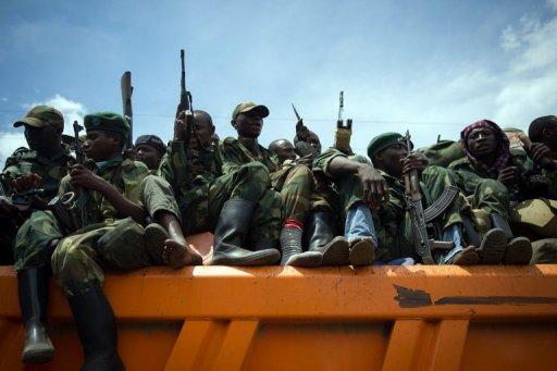 Des rebelles du M23 se retirent de la ville de Goma, le 1er décembre 2012 AFP/Archives Phil Moore