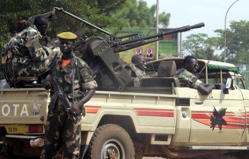 Des membres de la garde présidentielle à Bangui, le 15 mars 2005 AFP/Archives Issouf Sanogo