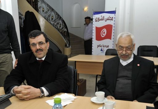 Le chef du parti islamiste Ennahda, Rached Ghannouchi (d) et le ministre de l'Intérieur, Ali Larayedh, le 22 février 2013 à Tunis AFP Fethi Belaid