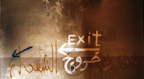 Un graffiti dans le fief des insurgés, à Benghazi, Libye, le 11 mars 2011. REUTERS/Finbarr O'Reilly