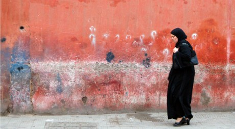 Woman Walking in Marrakech, by DavidDennisPhotos.com via Flickr CC