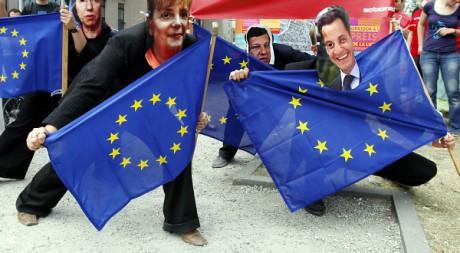 Des activistes portant des masques de dirigeants européens à Bruxelles. REUTERS/Thierry Roge
