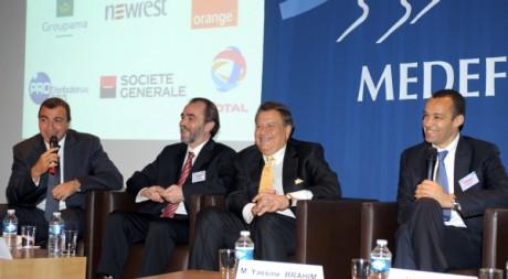Saïd Aïdi (barbu) et d'autres ministres tunisiens à la conférence sur l'investissement fin mai à La Baule. AFP/Eric Piermont