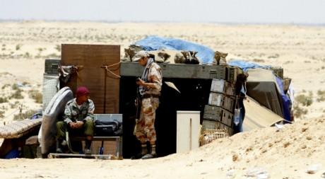 Des rebelles à la frontière avec Ajdabiyah, le 22 juin 2011. REUTERS/Mohamed Abd El Ghany