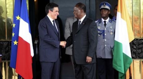 Le Premier ministre français François Fillon avec Alassane Ouattara, le 15 juillet 2011, à Abidjan. REUTERS/Luc Gnago