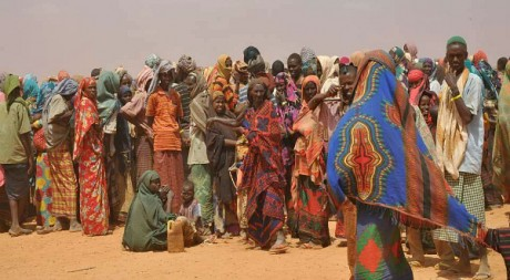 Queuing for registration in the heat of the sun, by DFID - UK Department for International Development via Flickr CC