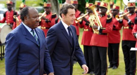 Ali Bongo et Nicolas Sarkozy à Franceville (Gabon), le 24 février 2010. REUTERS/Philippe Wojazer