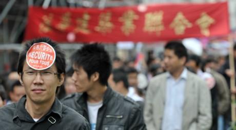 Manifestation de la communauté chinoise de Paris le 20 juin 2010. AFP/BERTRAND LANGLOIS