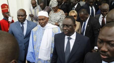 L'ancien président Abdoulaye Wade avec son successeur Macky Sall, 2 avril 2012, REUTERS/Joe Penney