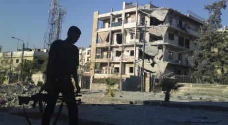 Un membre de l'Armée libre syrienne à Alep / Reuters