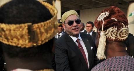 Mohammed VI en visite officielle en Côte d'Ivoire le 19 mars 2013.  ISSOUF SANOGO / AFP