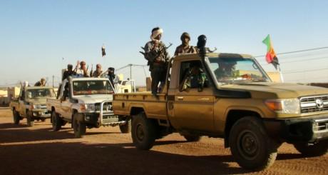 Des partisans du MNLA en voiture à Kidal / REUTERS