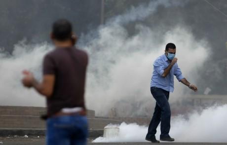 Evacuation par la force des sit-in pro-Morsi, le 14 août, au Caire. REUTERS/Amr Abdallah Dalsh