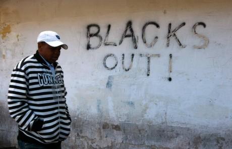 Un immigré africain se promenant dans les rues de la Valette à Malte, REUTERS / Darrin Zammit Lupi