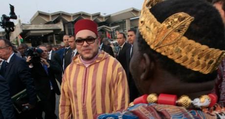 Mohammed VI, lors de sa visite en Côte d'Ivoire, février 2014 / REUTERS