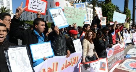 Dés étudians lors de la manifestation de Rabat, 23 mars 2014 / AFP