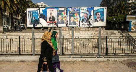Les affiches des candidats à l'élection présidentielle algérienne / REUTERS
