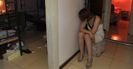 Une prostituée chinoise interpellée à Pékin en 2011. Crédit photo: CHINA OUT AFP PHOTO