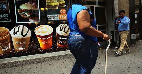 Une affiche publicitaire de McDonalds dans une rue de Brooklyn à New York en 2013. Crédit photo: SPENCER PLATT/AFP
