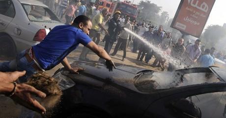Des affrontements entre des manifestants et la police, le 2 août 2012 au Caire. MOHAMED HOSSAM / AFP