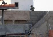 Tunisie: la police prépare l'assaut contre des hommes armés retranchés dans une maison