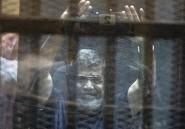 Egypte: le président destitué Morsi et une centaine d'accusés condamnés