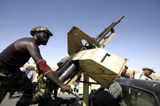 Des combattants du CNT libyen, le 11 septembre 2011 près de Bani Walid AFP Joseph Eid