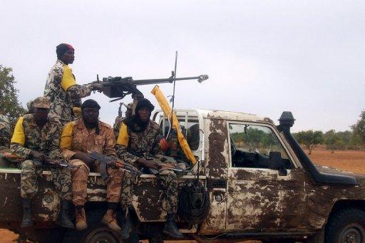 Des soldats de l'armée malienne reviennent en pick-up d'une opération dans le nord du Mali, le 18 juillet 2011. AFP/Archives Serge Daniel