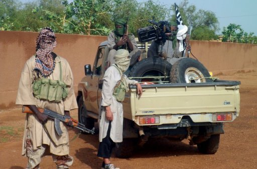 Des combattants du groupe islamiste Ansar Dine à Kidal, le 7 août 2012 dans le nord du Mali AFP/Archives Romaric Ollo Hien