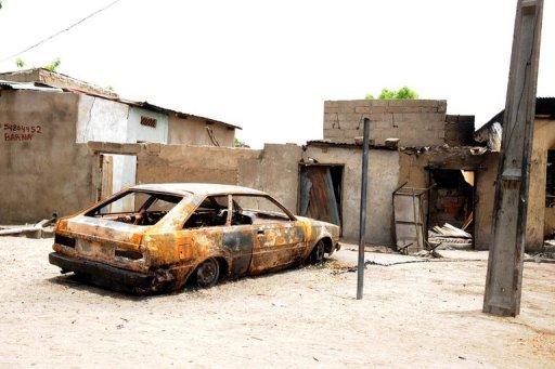 L'épave d'un véhicule détruit par une explosion due au groupe islamiste Boko Haram, le 10 mai 2012 à Maiduguri, au Nigeria AFP/Archives Pius Utomi Ekpei