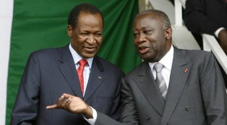 Gbagbo et Compaoré lors d'une cérémonie au stade Bouake, Côte d'Ivoire, le 30 juillet 2007. REUTERS/Luc Gnago