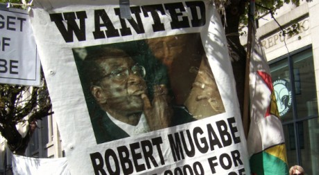Wanted: Robert Mugabe poster outside the Zimbabwe information centre, by Ben Sutherland via Flickr CC