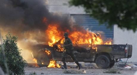 Des combats à Syrte, le 12 octobre 2011. REUTERS/Anis Mili