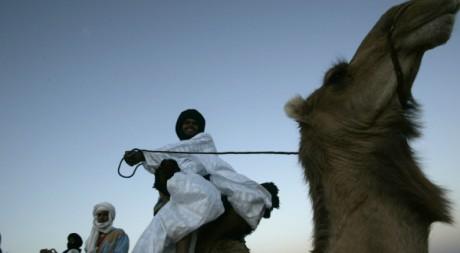 Nomades sur des Chameaux.  Reuters/Rafael Marchante