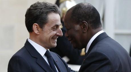Nicolas Sarkozy accueille Alassane Ouattara à l'Elysée, le 26 janvier 2012. REUTERS/Gonzalo Fuentes