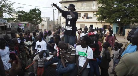 Un membre de Y en a marre se produit lors d'un concert communautaire, près de de Dakar, juin 2011, REUTERS/Finbarr O'Reilly