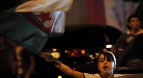 Scènes de liesse à Alger après la victoire de l'Algérie contre l'Angleterre le 18 juin 2010. AFP/FAYEZ NURELDINE