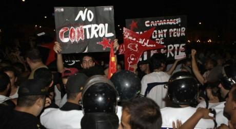 Des Tunisiens lors d'une manifestation contre le pouvoir islamiste, août 2012. REUTERS/Zoubeir Souissi
