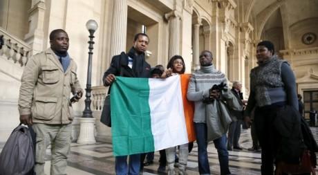 Des proches de Firmin Mahé, cour d'Assises de Paris, le 7 décembre 2012. © FRANCOIS GUILLOT / AFP
