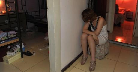 Une prostituée chinoise interpellée à Pékin en 2011. Crédit photo: CHINA OUT AFP PHOTO